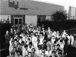"""Intel's staff of just over 100 employees outside their first building in Mountain View, in 1969. Front left, co-founder Robert Noyce; front right, co-founder Gordon Moore. """" alt=""""Intel's staff of just over 100 employees outside their first building in Mountain View, in 1969. Front left, co-founder Robert Noyce; front right, co-founder Gordon Moore."""