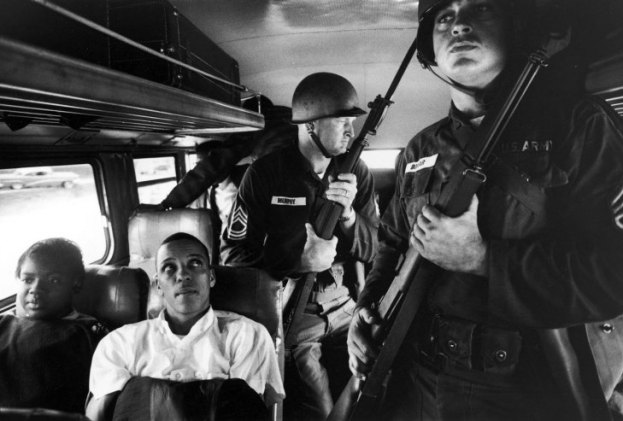 Julia Aaron and David Dennis, along with 25 other freedom riders and several members of the National Guard, travel from Montgomery, Ala., to Jackson, Miss.