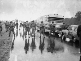 Just shy of the Mississippi-Alabama border, members of the Alabama National Guard surround a bus carrying freedom riders.