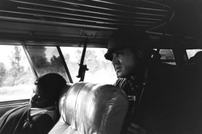A freedom rider and member of the National Guard on a bus in the Deep South