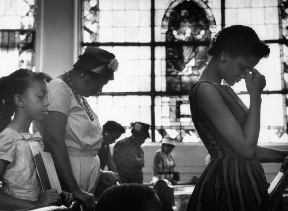 A congregation in Alabama prays for the safety of freedom riders