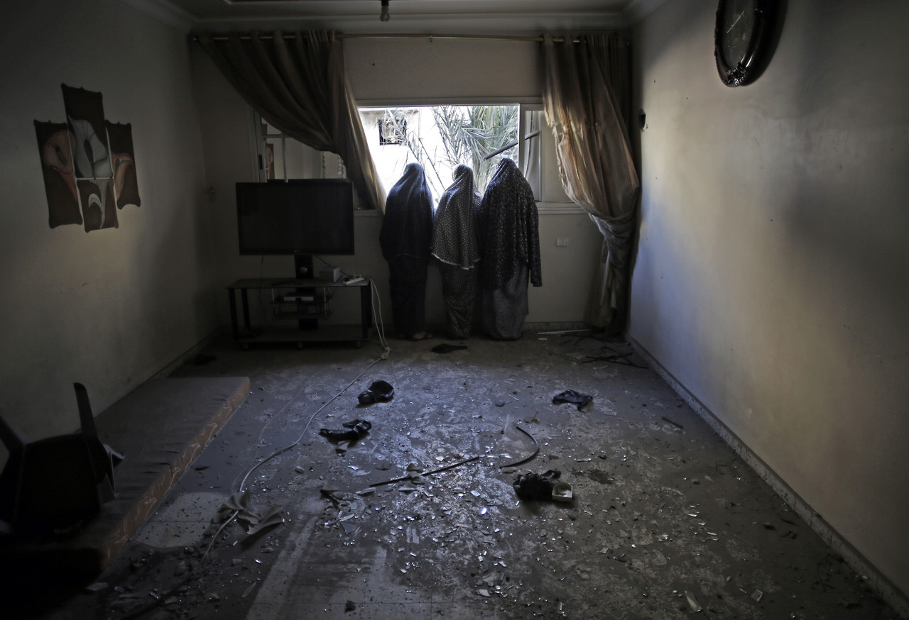 Window at night from outside - Palestinian Women Look Outside From The Window Of Their Destroyed House Following Late Night Israeli Strikes In Gaza City On Wednesday Aug 20 2014
