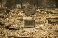 An oven remains standing amid ruins of a home leveled by the Valley Fire.