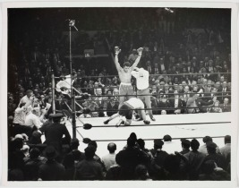 Photograph of Muhammad Ali and Oscar Bonavena in the ring 1970. Photo by Lloyd W. Yearwood. © Estate of Lloyd W. Yearwood