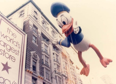Donald Duck, looking dapper as ever, delights paradegoers in 1962. Macy's photo