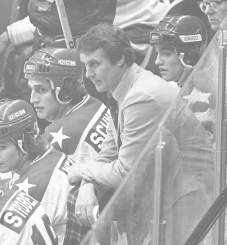U.S. coach Herb Brooks, center, looks from the bench during the closing minutes. (AP)