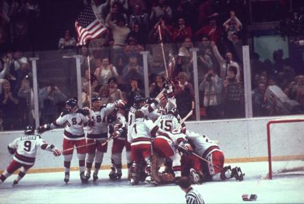 The U.S. hockey team pounces on goalie Jim Craig after the shocking 4-3 win. (AP)
